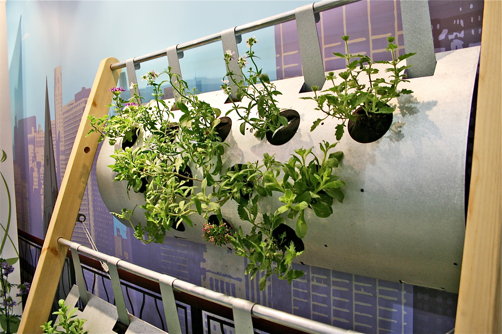 The vertigro modular growing system at grand designs live for Wall garden system