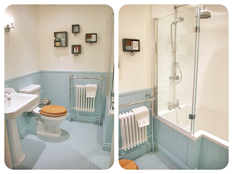 Blue pastel painted panelling in period style bathroom