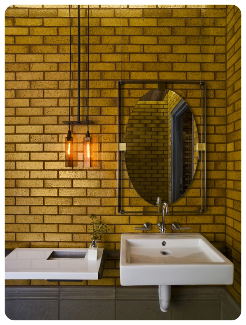 Gold Metro Or Subway Tiling On Full Bathroom Wall