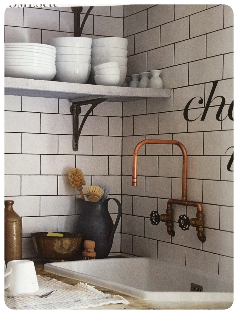 Copper pipe tap and vintage styling against white metro subway tiles