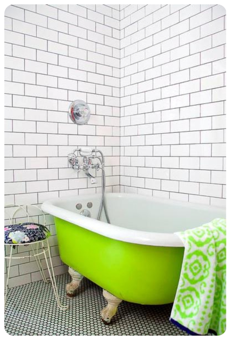 Lime green slipper bath in white metro tiled bathroom
