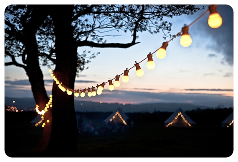 Glamping with field festoons via Lights4Fun