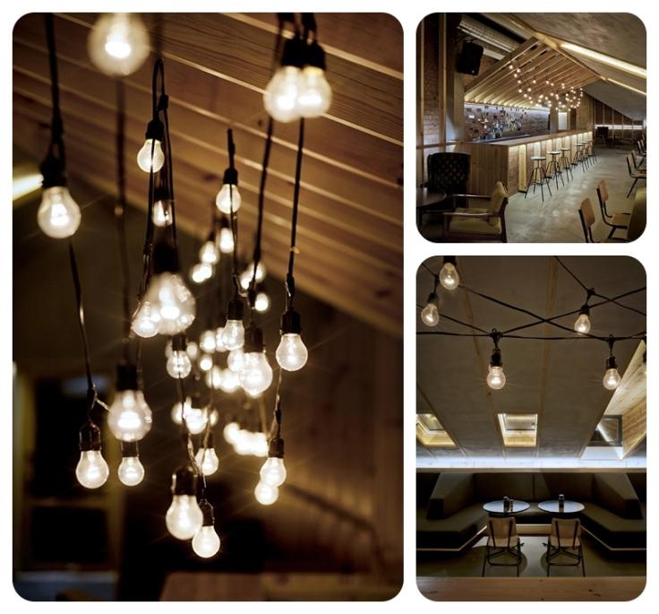 Black festoon lighting in bar by InBlum Architects in Minsk Belarus