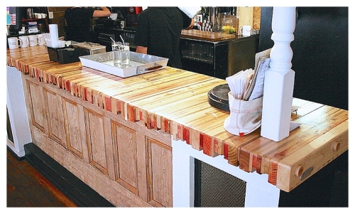 Reclaimed timber slatted bar top in wood and red