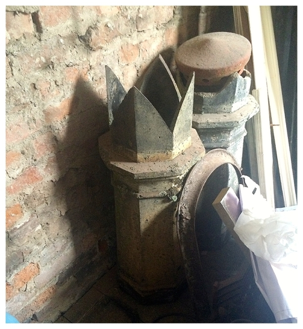 Period chimney pots taken off the stacks and roof