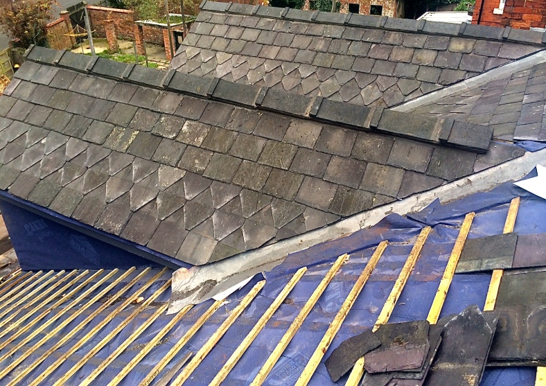 Dormer roofs using reclaimed slates and fishtail pattern