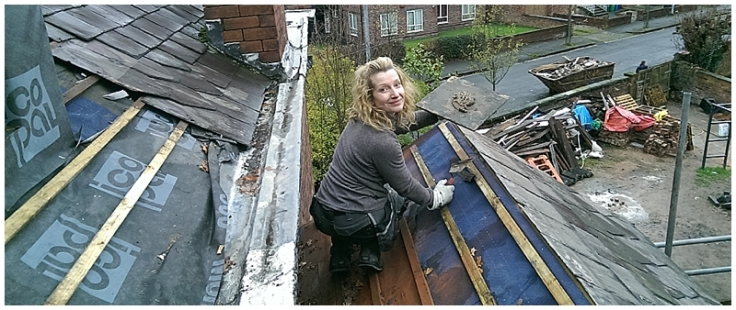 Lady builder on roof