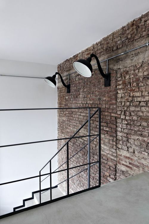 Bare brick with contemporary industrial hallway