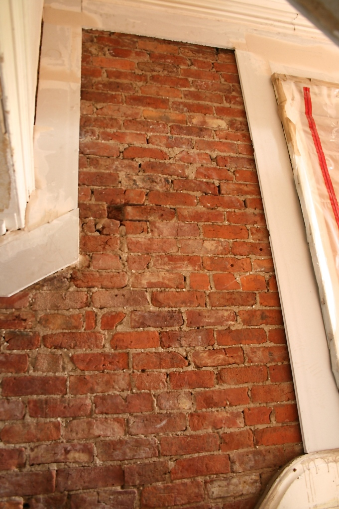 Framing exposed bare brick with plasterboard