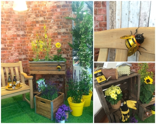 Natural timbers and wooden planters in bee friendly garden space with reclaimed brick backdrop