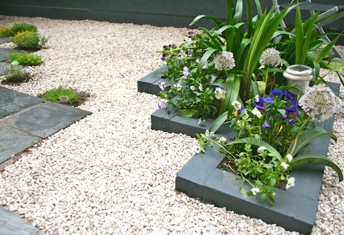 Central raised flower beds painted grey
