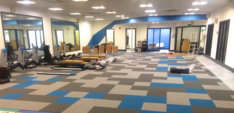 Pixel flooring in carpet tiles with vivid blue stripe