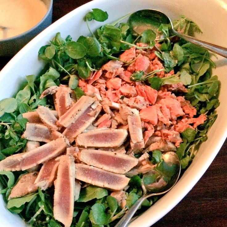 Seared yellow fin tuna and wild salmon on watercress