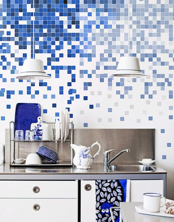 Blue and white pixel tiles on kitchen wall