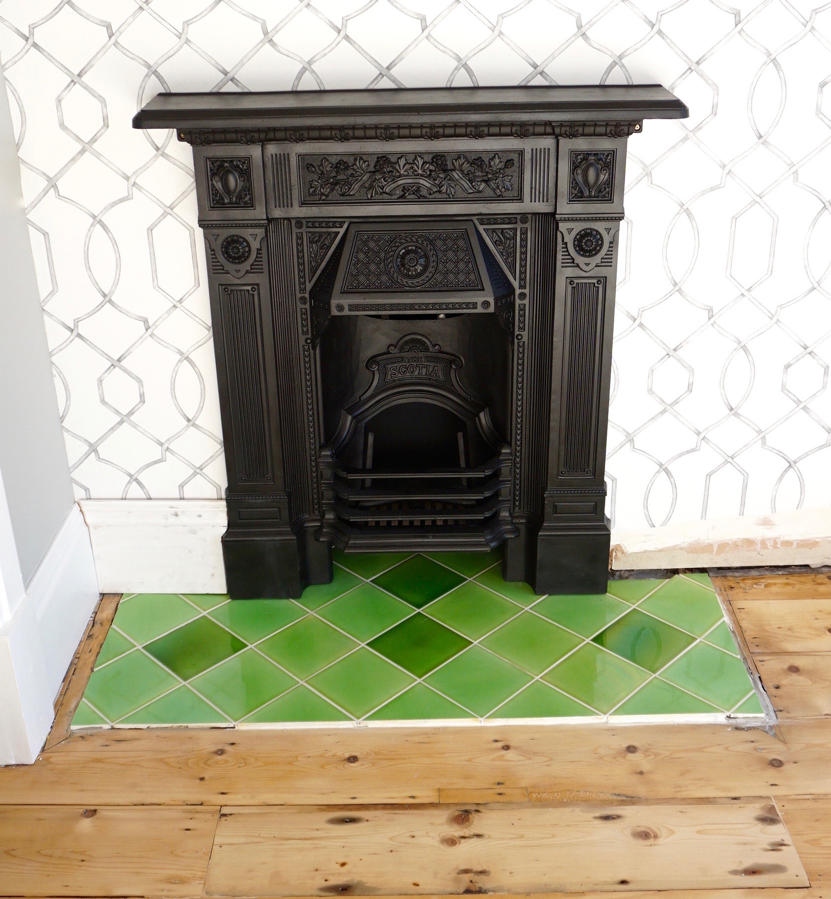 DSC05720 Green reclaimed gloss tiles in Edwardian fireplace with black cast iron surround